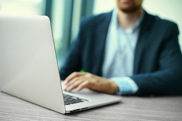 financial advisor using laptop
